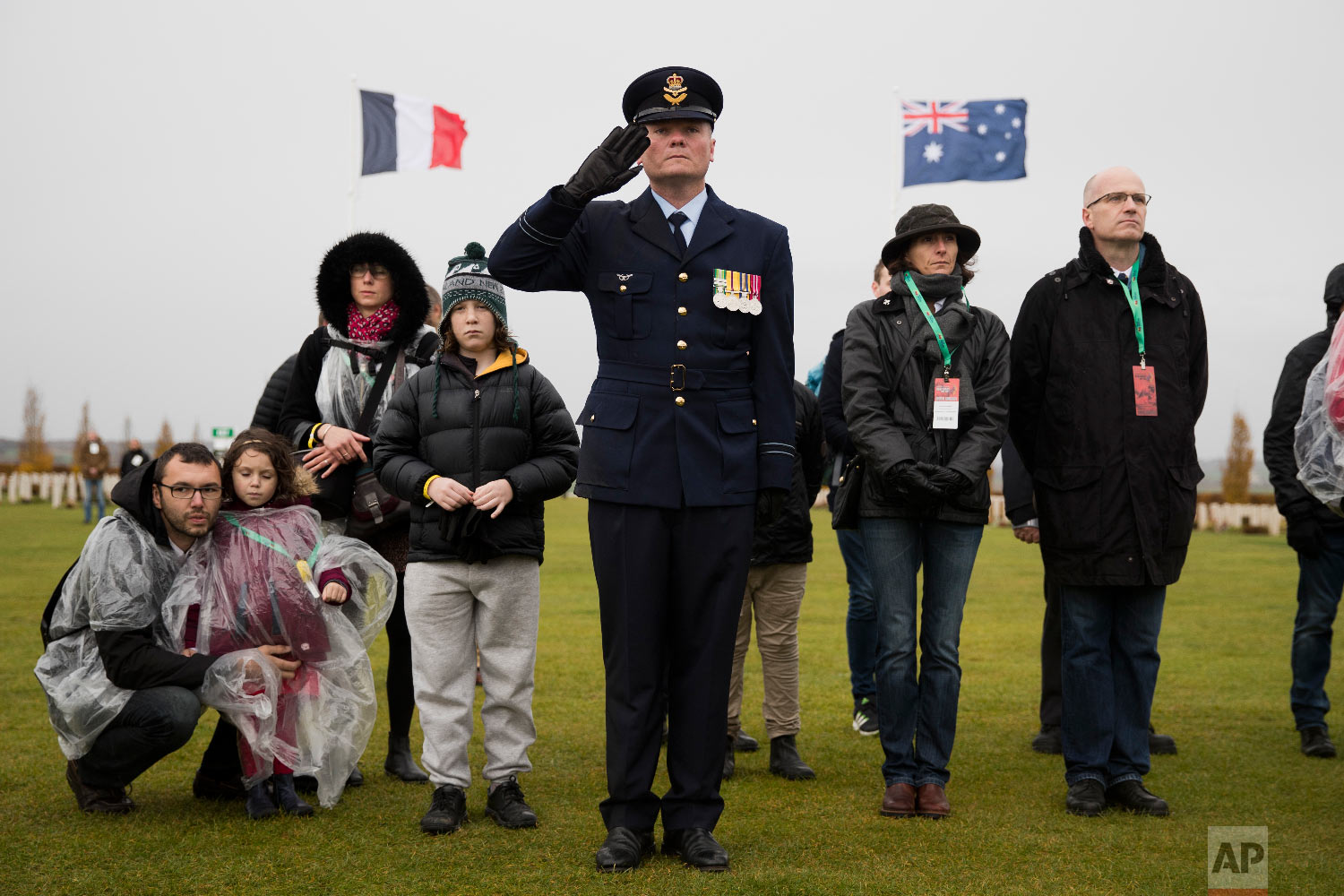 An Australian soldier listens along with visitors as French and Australian national anthems are played during an Armistice ceremony at the World War I Australian National Memorial in Villers-Bretonneux, France, Nov. 11, 2018. (AP Photo/Francisco Seco)