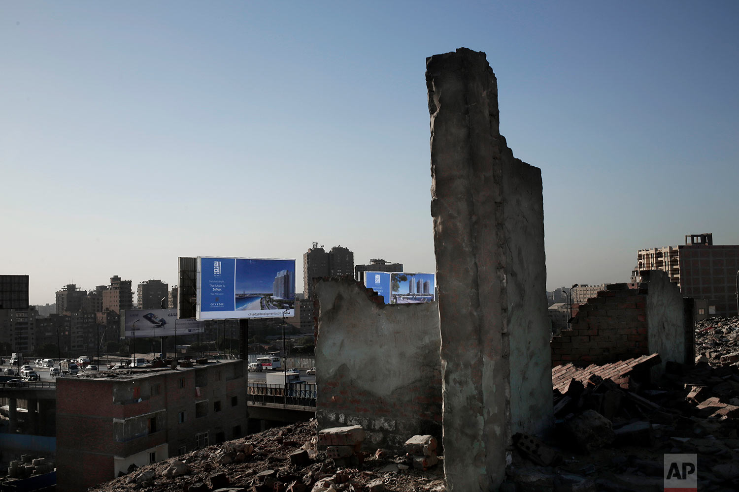 This Oct. 28, 2018 photo, shows billboard advertisements from slum area Ezbet Khairallah, in Cairo, Egypt. (AP Photo/Nariman El-Mofty)
