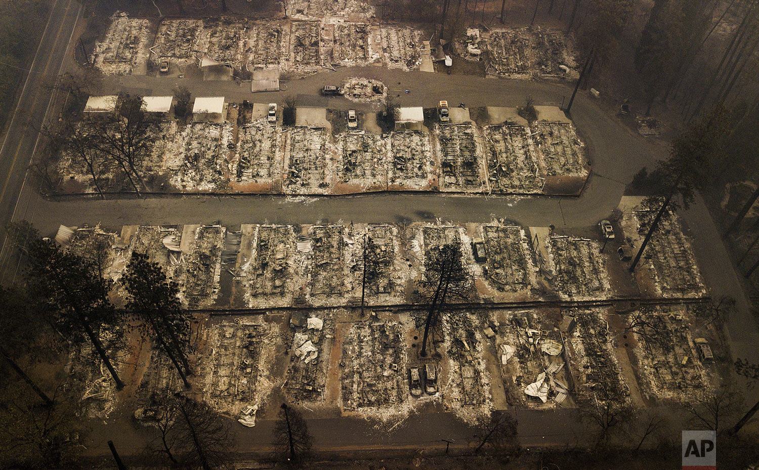 This aerial photo shows the remains of residences leveled by the wildfire in Paradise, Calif., on Thursday, Nov. 15, 2018.  (AP Photo/Noah Berger)