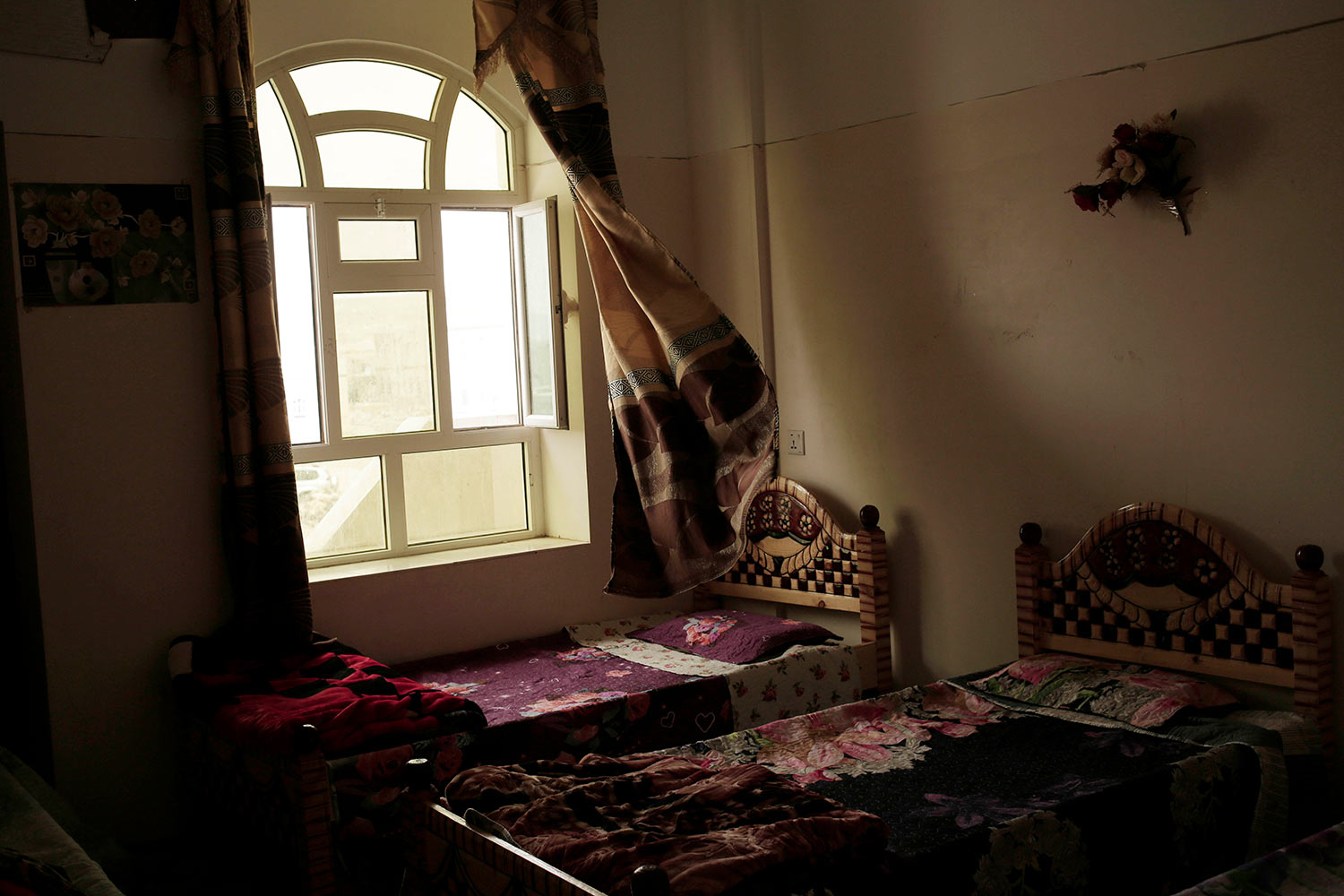This July 28, 2018, photo shows a bedroom at the Rehabilitation Of Children Recruited and Impacted By War in Yemen Project center in Marib, Yemen. The Houthis have inducted 18,000 child soldiers into their rebel army since the beginning of the war in 2014, a senior Houthi military official acknowledged to The Associated Press. (AP Photo/Nariman El-Mofty)