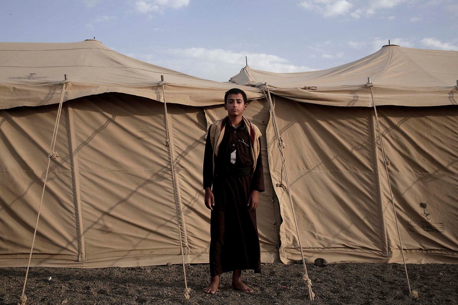 Sadek, a 14 year-old former child soldier, poses for a photograph at a camp for displaced persons where he took shelter with his family, in Marib, Yemen, in this July 27, 2018, photo. (AP Photo/Nariman El-Mofty)