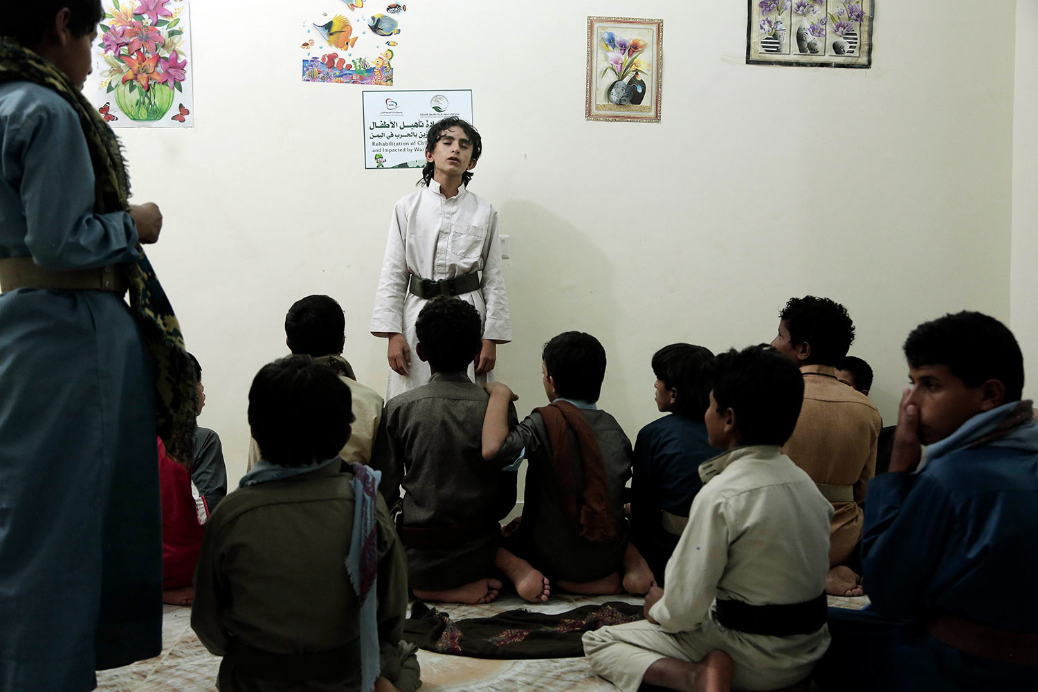 Boys recite poems during a session at a rehabilitation center for former child soldiers in Marib, Yemen, in this July 25, 2018, photo. (AP Photo/Nariman El-Mofty)
