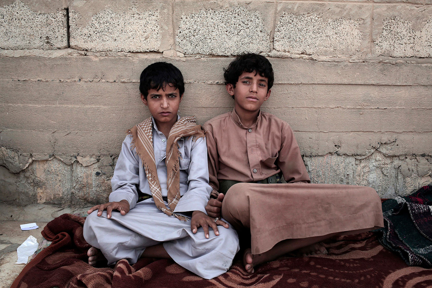 In this July 27, 2018 photo, 14 year-old Morsal Al Amery, right, and 14 year-old Abdel Hamid Saleh, pose for a photograph at a camp for displaced persons where they took shelter, in Marib, Yemen, (AP Photo/Nariman El-Mofty)