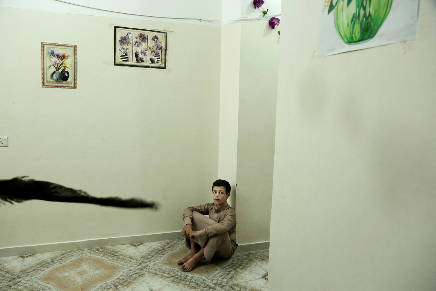 In this July 25, 2018 photo, 14 year-old Abdel Majeed Mohammed Al Folaihy sits on the floor at the Rehabilitation Of Children Recruited and Impacted By War in Yemen Project center in Marib, Yemen, (AP Photo/Nariman El-Mofty)