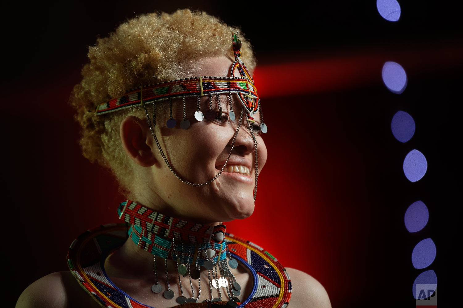 Kenyan contestant Lucianah Nyawira, 21, wears a traditional costume as she performs in the Mr. & Miss Albinism East Africa contest, organized by the Albinism Society of Kenya, in Nairobi, Kenya, Nov. 30, 2018. (AP Photo/Ben Curtis)