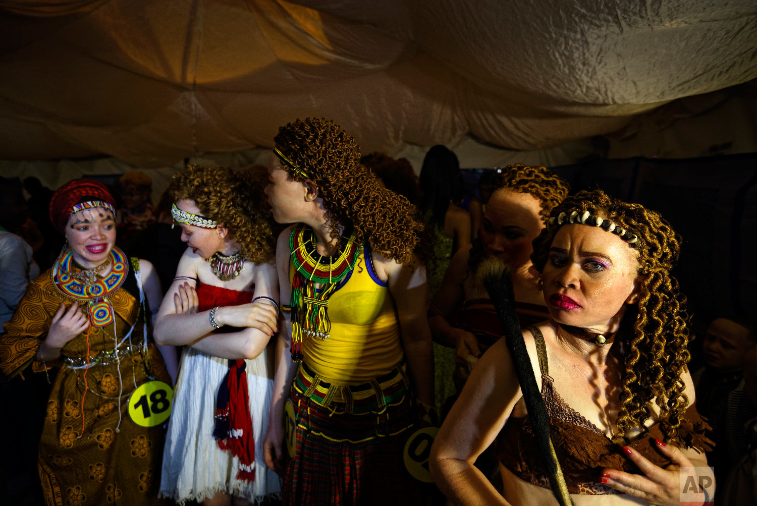 Contestants queue up to take the stage in the Mr. & Miss Albinism East Africa contest, organized by the Albinism Society of Kenya, in Nairobi, Kenya, Nov. 30, 2018. (AP Photo/Ben Curtis)