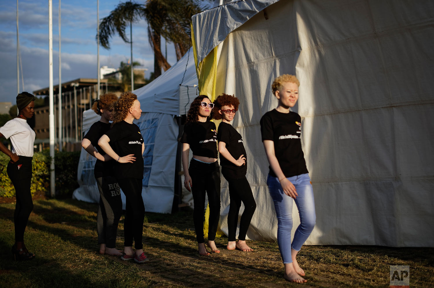 Contestants practice their catwalk moves as they prepare for the Mr. & Miss Albinism East Africa contest, organized by the Albinism Society of Kenya, in Nairobi, Kenya, Nov. 30, 2018. (AP Photo/Ben Curtis)