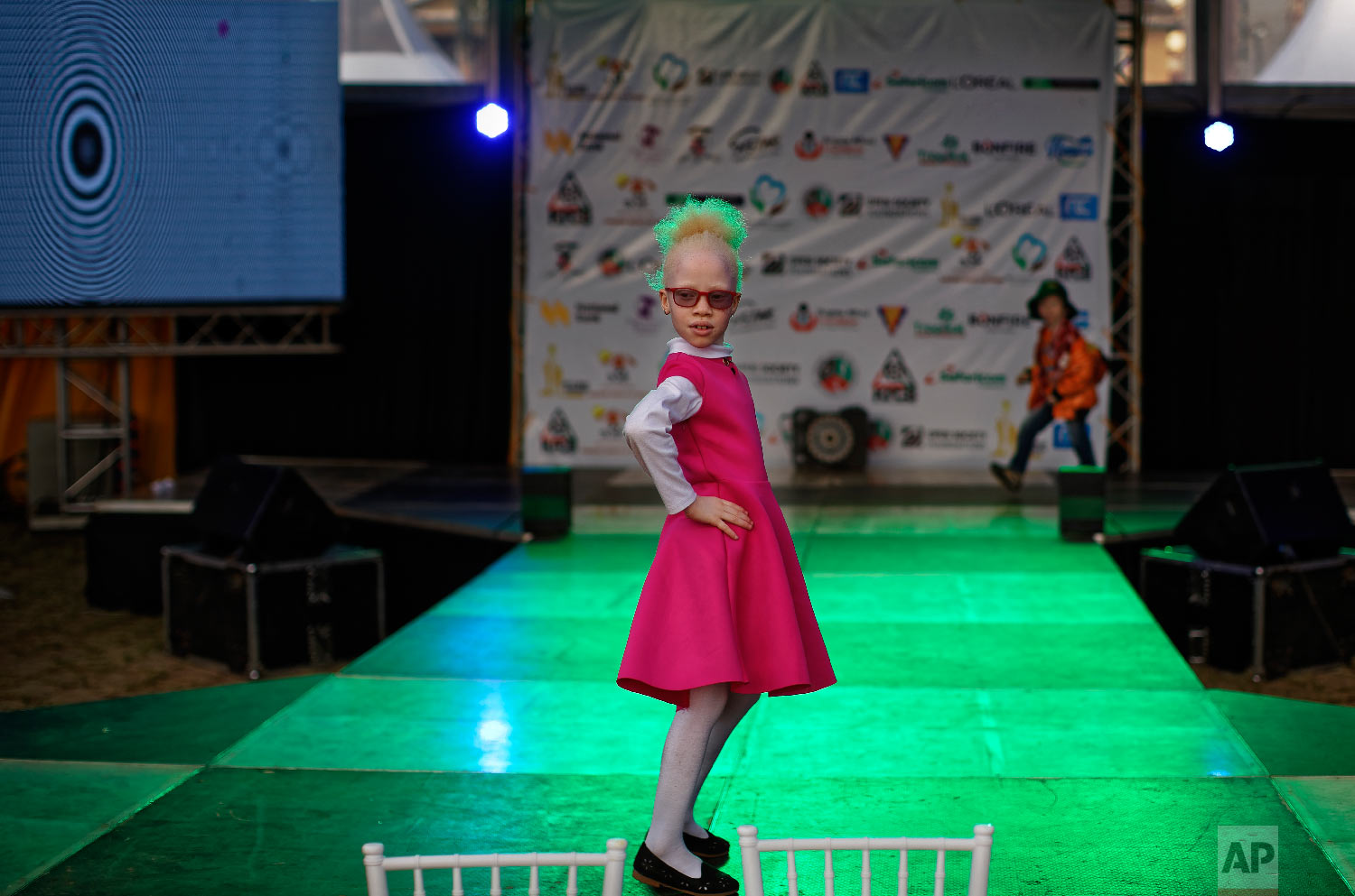 Shirlyne 7, tries her hand on the catwalk before the start of the Mr. & Miss Albinism East Africa contest, organized by the Albinism Society of Kenya, in Nairobi, Kenya, Nov. 30, 2018. (AP Photo/Ben Curtis)