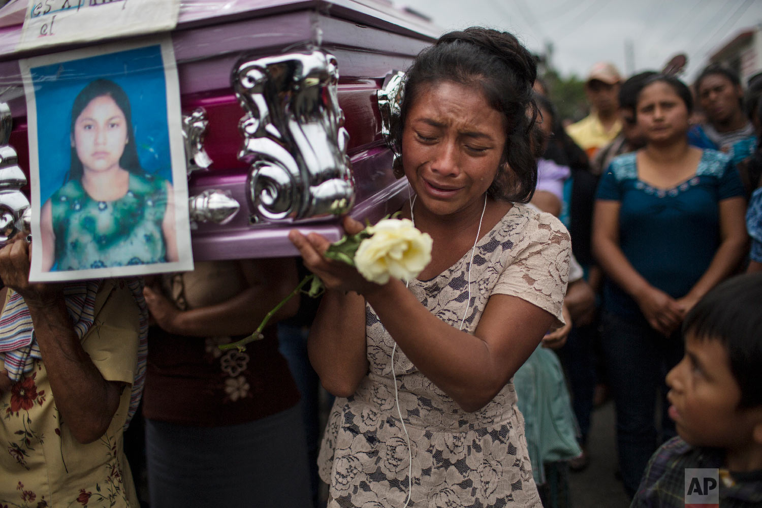 "Yoselin Rancho cries while carrying the remains of her best friend, Etelvina Charal, who died in the eruption of the Volcan de Fuego, or ""Volcano of Fire,"" in San Juan Alotenango, Guatemala, on June 10, 2018. (AP Photo/Rodrigo Abd)"