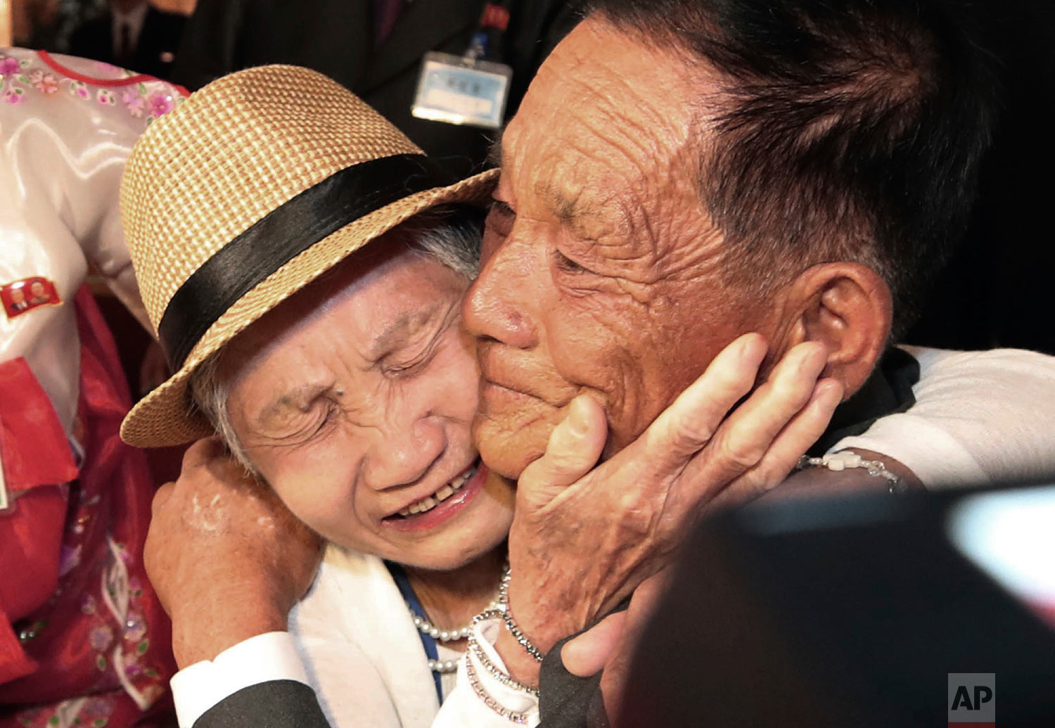South Korean Lee Keum-seom, 92, weeps with her North Korean son, Ri Sang Chol, 71, during the Separated Family Reunion Meeting at the Diamond Mountain resort in North Korea on Aug. 20, 2018. Dozens of elderly South Koreans crossed the heavily fortified border into North Korea for heart-wrenching meetings with relatives most haven't seen since they were separated by the turmoil of the Korean War. (Lee Ji-eun/Yonhap via AP)