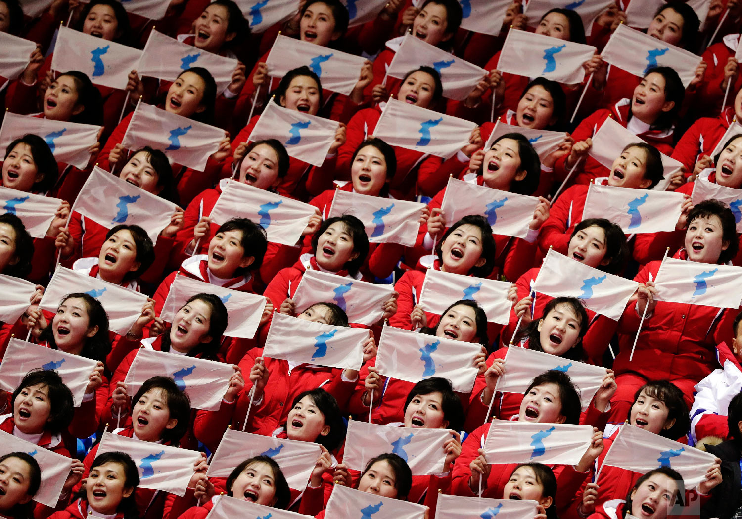 North Korean supporters hold up Korean unification flags during the ladies' 500 meters short-track speedskating at the 2018 Winter Olympics in Gangneung, South Korea, on Feb. 10, 2018. (AP Photo/Julie Jacobson)