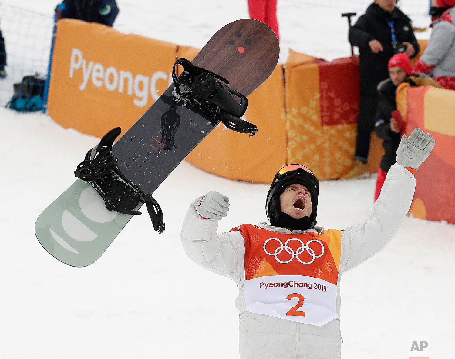 Shaun White, of the United States, celebrates winning gold after his run during the men's halfpipe finals at the 2018 Winter Olympics in Pyeongchang, South Korea, on Feb. 14, 2018. (AP Photo/Gregory Bull)
