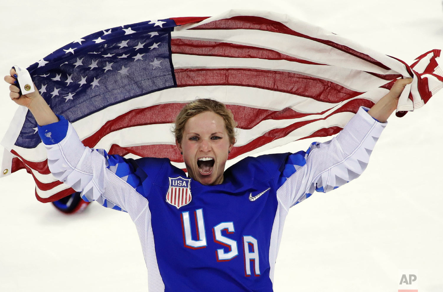 Jocelyne Lamoureux-Davidson, of the United States, celebrates after winning against Canada in the women's gold medal hockey game at the 2018 Winter Olympics in Gangneung, South Korea, on Feb. 22, 2018. (AP Photo/Matt Slocum)