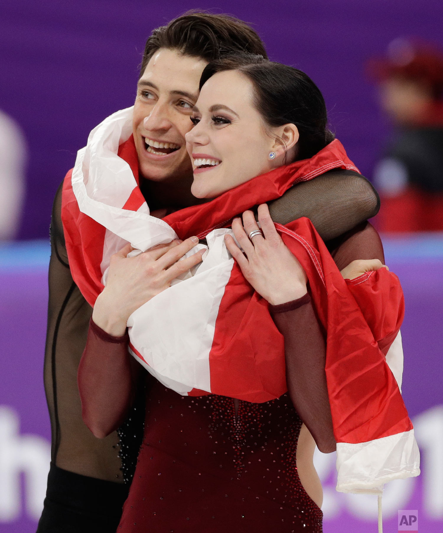 Tessa Virtue and Scott Moir of Canada celebrate during the venue ceremony after winning the gold medal in the ice dance, free dance figure skating final at the 2018 Winter Olympics in Gangneung, South Korea, on Feb. 20, 2018. (AP Photo/David J. Phillip)