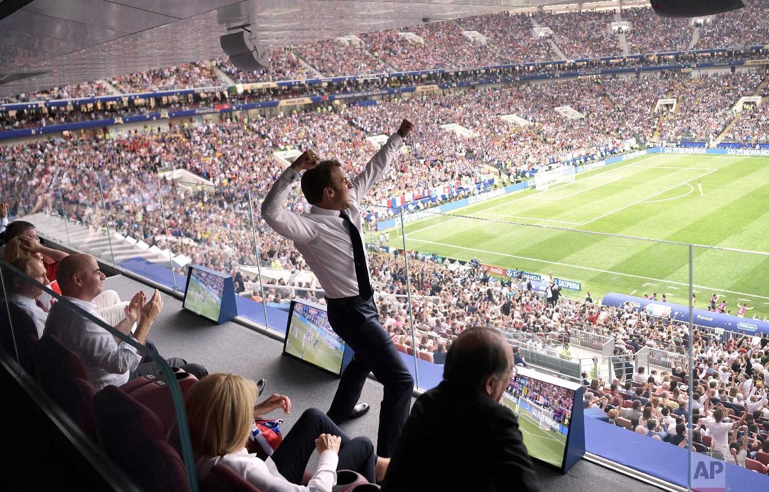 French President Emmanuel Macron cheers during the final match between France and Croatia at the 2018 soccer World Cup in the Luzhniki Stadium in Moscow, Russia, on July 15, 2018. (Alexei Nikolsky/Sputnik/Kremlin Pool Photo via AP)