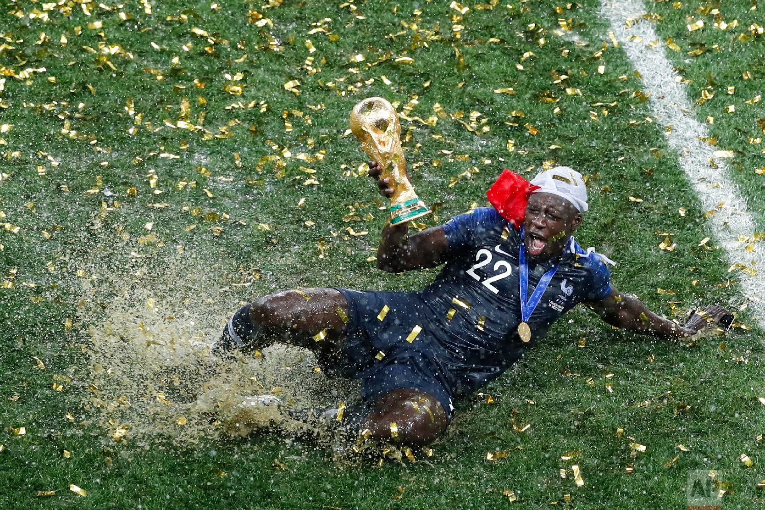 France's Benjamin Mendy celebrates with the trophy after his team won the final match against Croatia at the 2018 soccer World Cup in the Luzhniki Stadium in Moscow, Russia, on July 15, 2018. (AP Photo/Rebecca Blackwell)