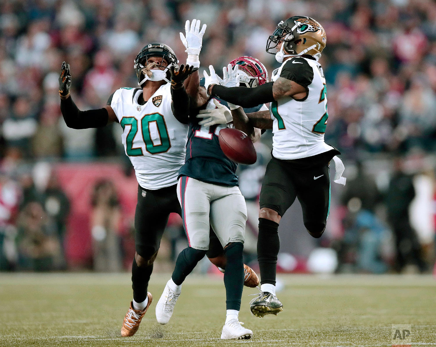 Jacksonville Jaguars cornerbacks Jalen Ramsey (20) and A.J. Bouye (21) break up a pass intended for New England Patriots wide receiver Brandin Cooks during the second half of the AFC championship NFL football game on Jan. 21, 2018, in Foxborough, Mass. (AP Photo/Charles Krupa)