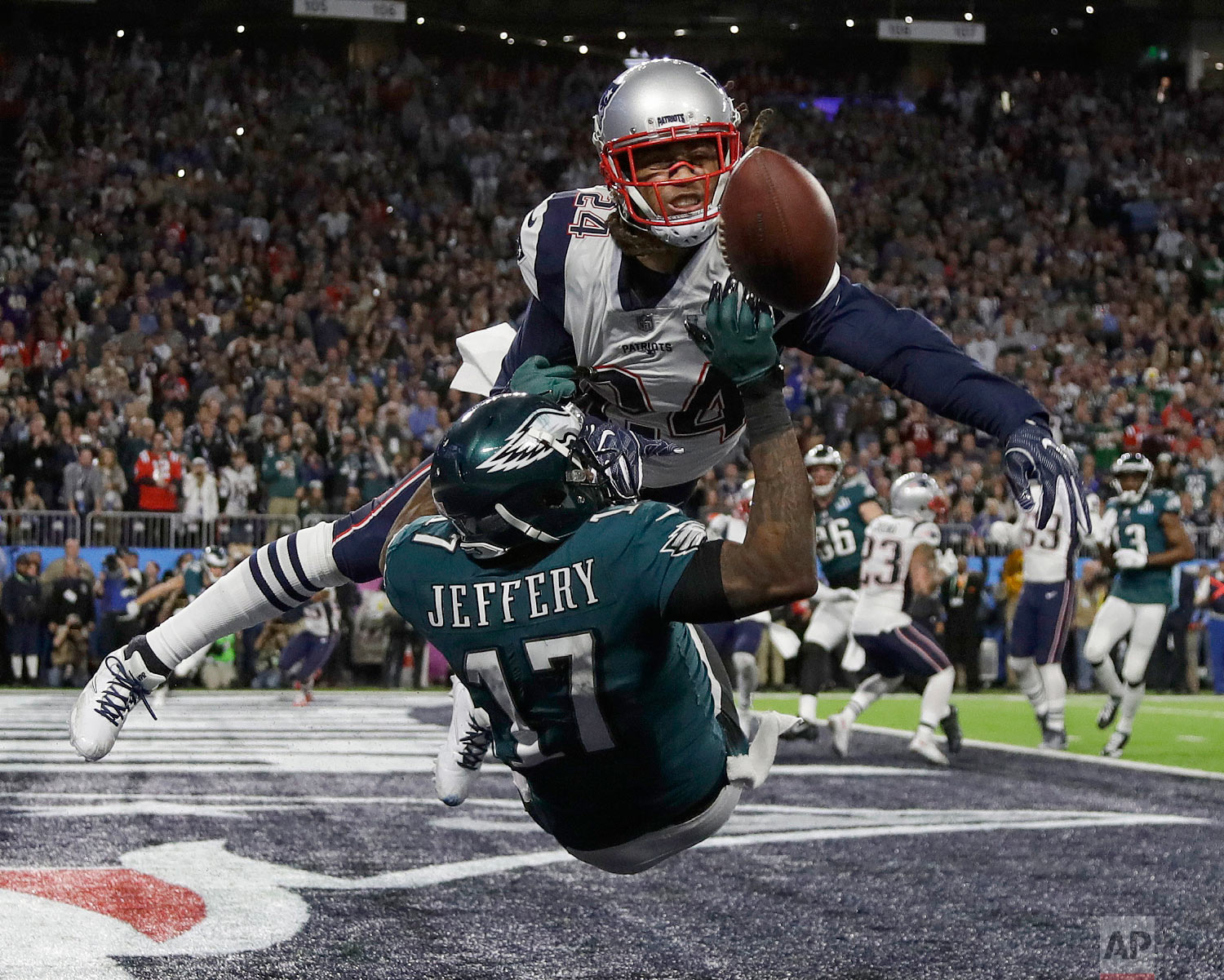 New England Patriots' Stephon Gilmore, top, breaks up a pass intended for Philadelphia Eagles' Alshon Jeffery during the first half of the NFL Super Bowl 52 football game on Feb. 4, 2018, in Minneapolis. (AP Photo/Matt Slocum)