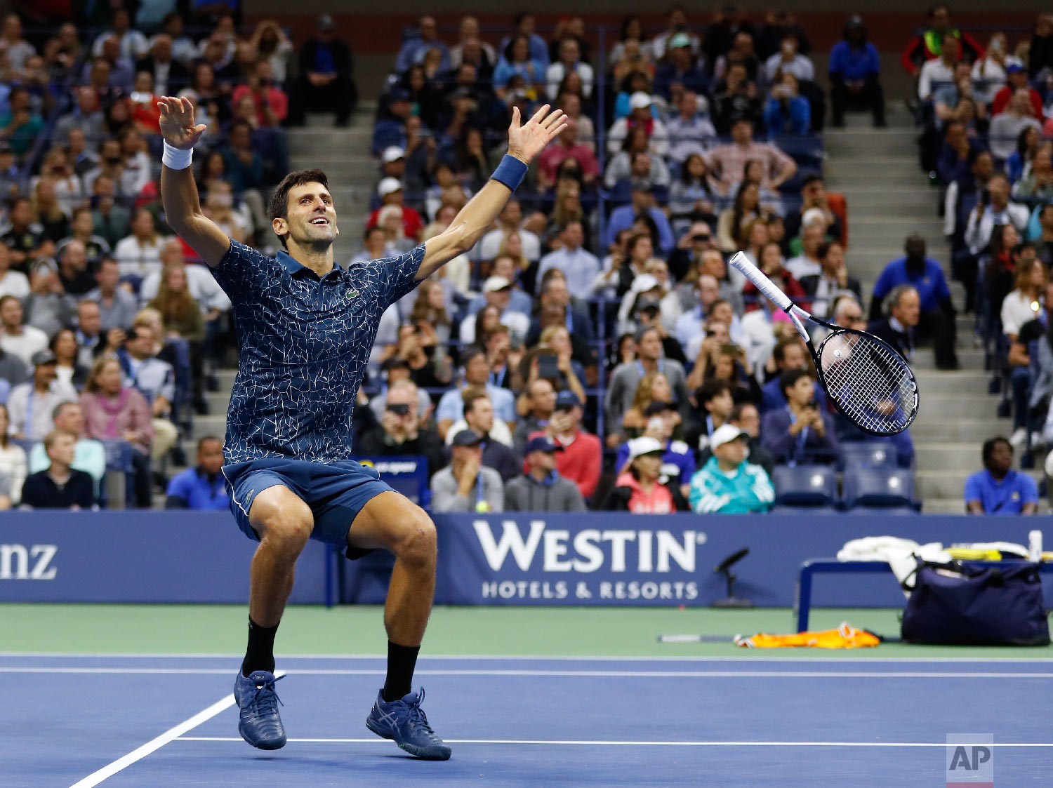 Novak Djokovic, of Serbia, celebrates after defeating Juan Martin del Potro, of Argentina, during the men's final of the U.S. Open tennis tournament on Sept. 9, 2018, in New York. (AP Photo/Adam Hunger)