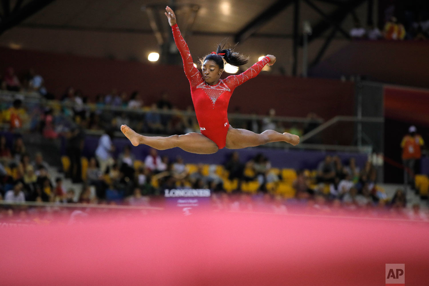Gold medalist Simone Biles of the United States performs on the floor on the second and last day of the apparatus finals of the Gymnastics World Championships in Doha, Qatar, on Nov. 3, 2018. (AP Photo/Vadim Ghirda)