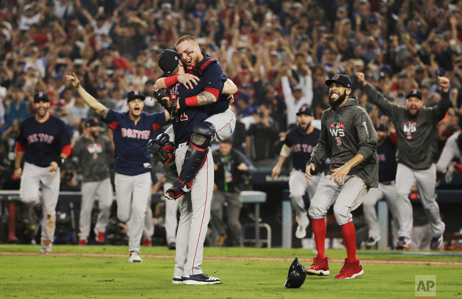 The Boston Red Sox celebrate after Game 5 of baseball's World Series against the Los Angeles Dodgers on Oct. 28, 2018, in Los Angeles. The Red Sox won the game 5-1 to win the series 4 games to 1. (AP Photo/Jae C. Hong)