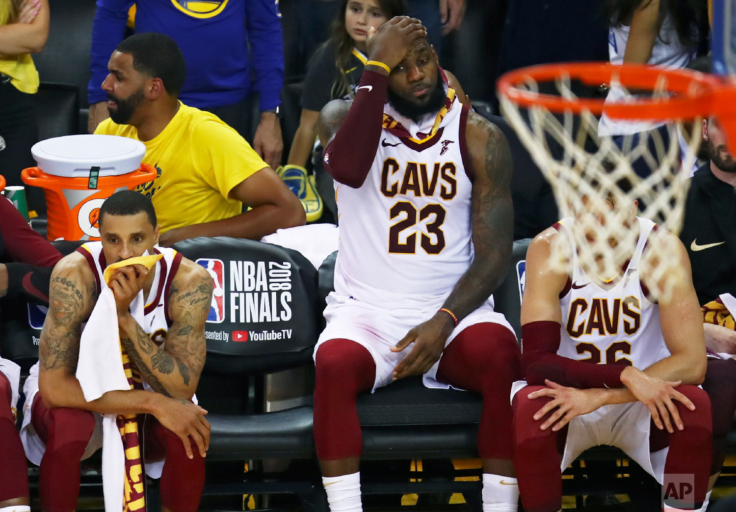 Cleveland Cavaliers forward LeBron James (23) sits on the bench between guards George Hill, left, and Kyle Korver during the second half of Game 2 of basketball's NBA Finals against the Golden State Warriors in Oakland, Calif., on June 3, 2018. The Warriors won 122-103. (AP Photo/Ben Margot)