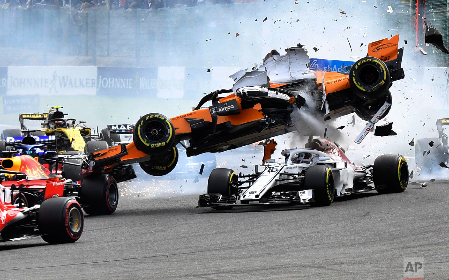 Mclaren driver Fernando Alonso of Spain goes over the top of Sauber driver Charles Leclerc of Monaco at the start of the Belgian Formula One Grand Prix in Spa-Francorchamps, Belgium, on Aug. 26, 2018. (AP Photo/Geert Vanden Wijngaert)