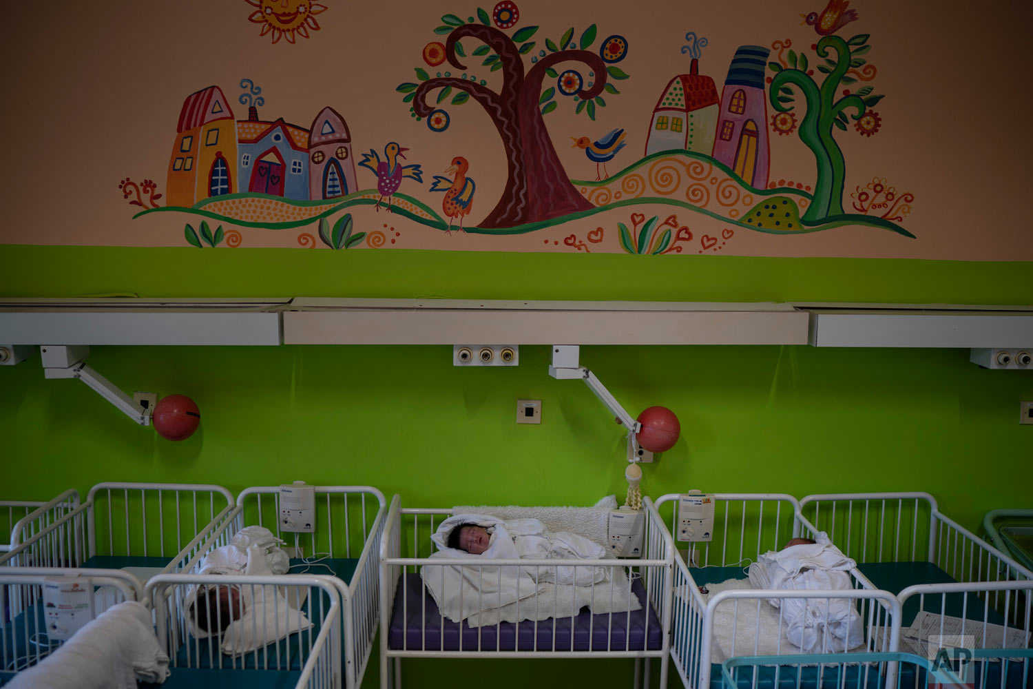 Three babies whose mothers absconded the hospital, rest in their cribs at the Kezmarok hospital on Nov. 16, 2018, in Kezmarok, Slovakia. (AP Photo/Felipe Dana)
