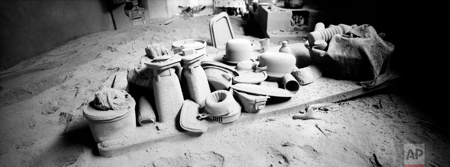 Kitchen utensils are coated with volcanic ash spewed by the Volcan de Fuego or Volcano of Fire, on June 9, 2018, in San Miguel Los Lotes, Guatemala. (AP Photo/Rodrigo Abd)