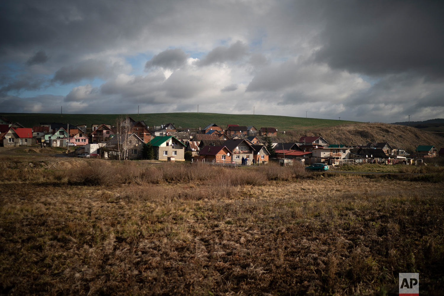 Dark clouds hover over Podhorany village after a storm on Nov. 14, 2018, near Kezmarok, Slovakia. (AP Photo/Felipe Dana)