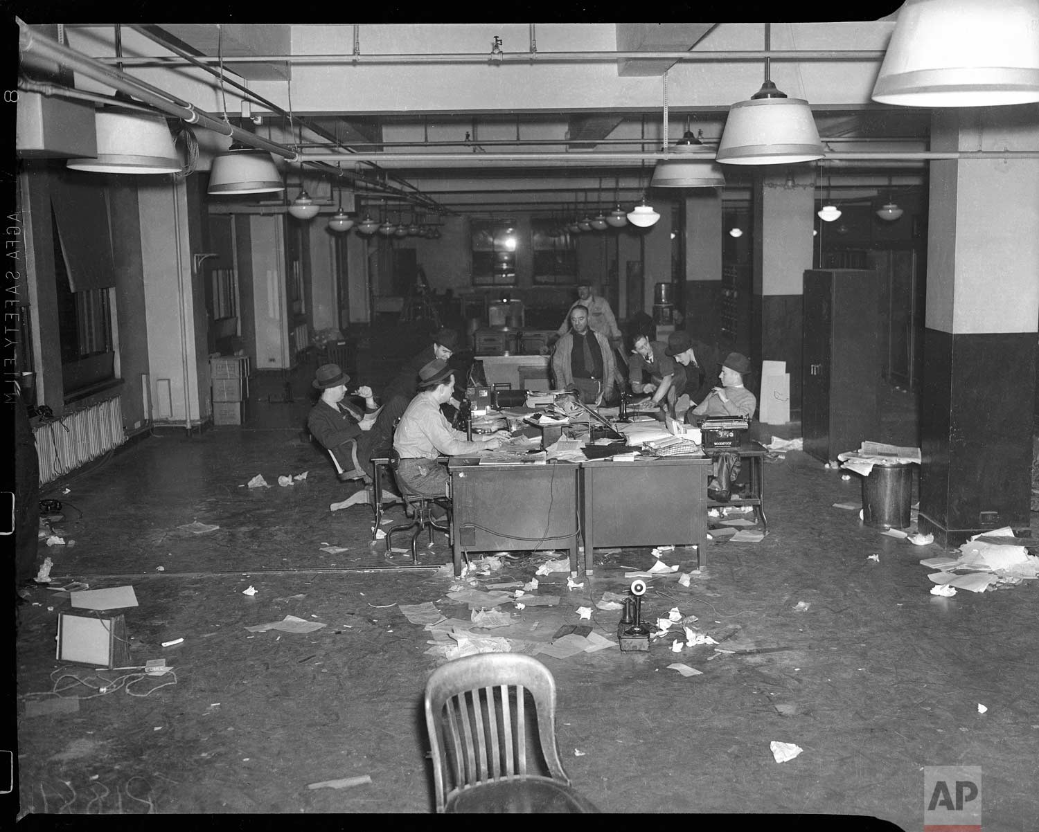 This photo shows the final days of reporters working at the 383 Madison Ave. office prior to the completion of the move to Rockefeller Center in New York, in Dec. 1938. (AP Photo/Corporate Archives)