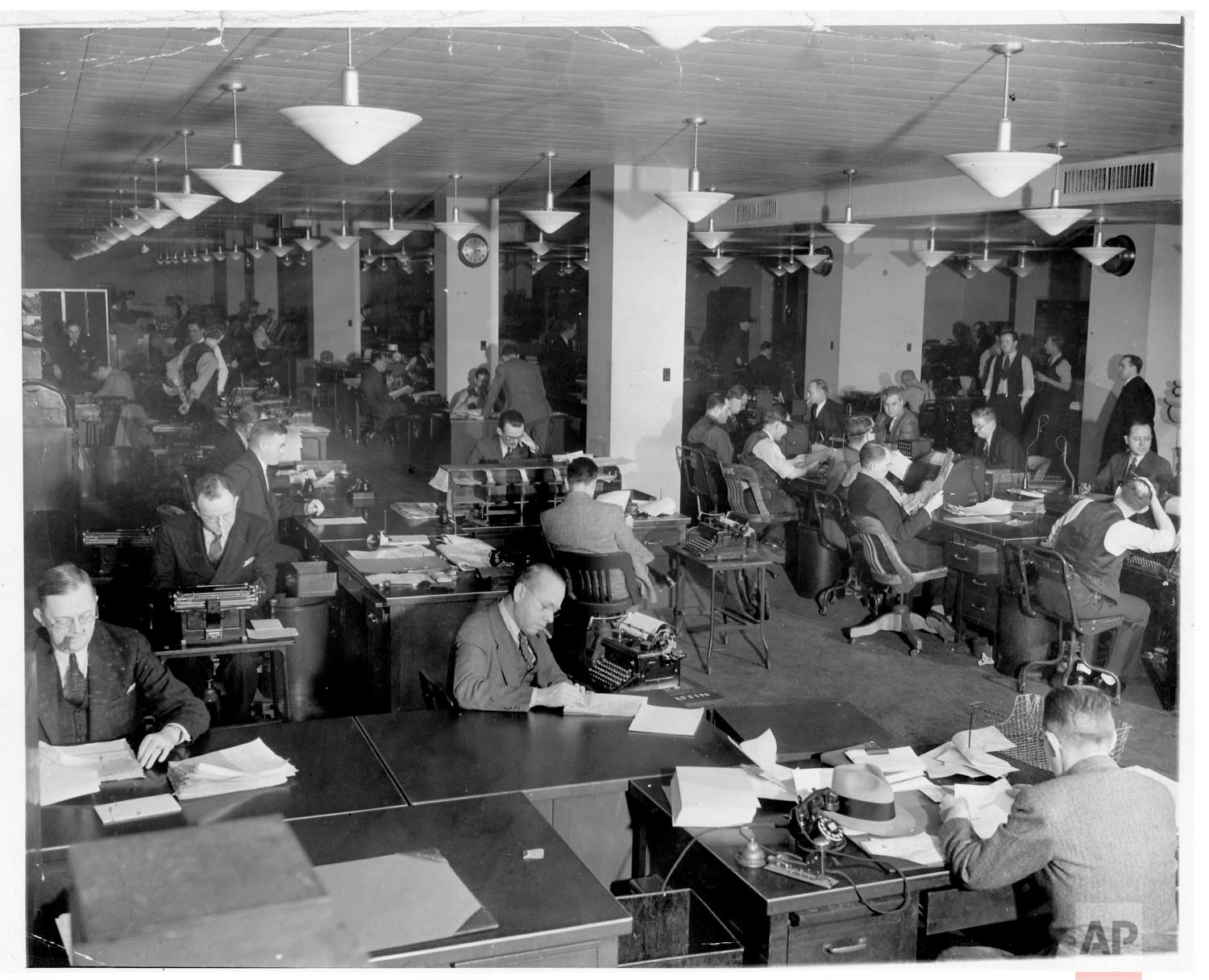 The newsroom at Associated Press headquarters at 50 Rockefeller Plaza, 1939. (AP Photo/Corporate Archives)