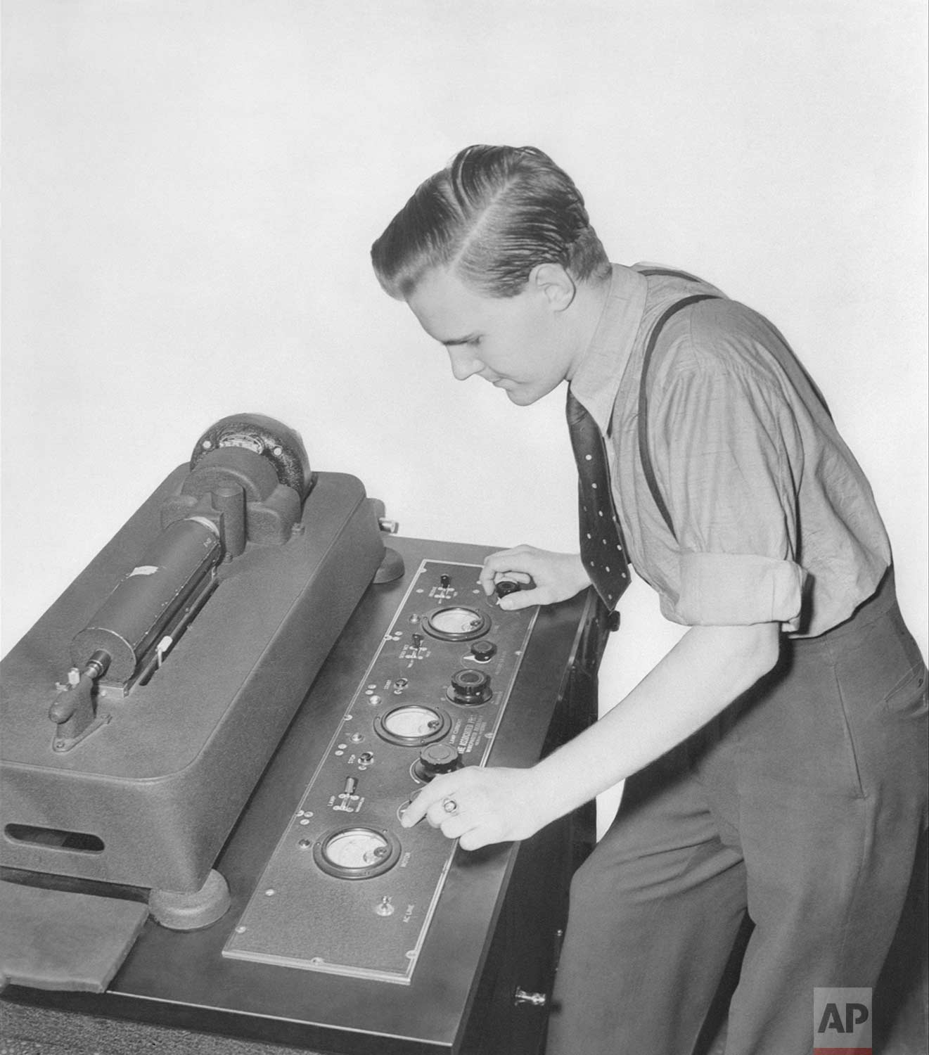 A wirephoto operator for the Associated Press is shown lining up the wirephoto receiver, New York, July 17, 1939.  (AP Photo)