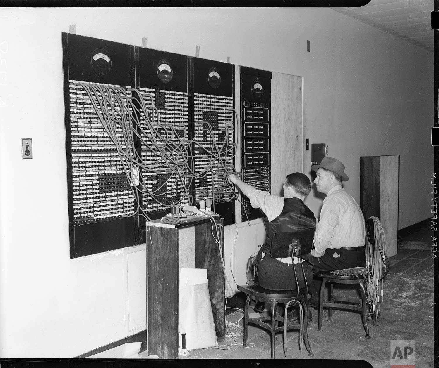Here is the front of the master switchboard in the new Associated Press building in Rockefeller Center in New York, Dec. 18, 1938. This switchboard, comprising 157 circuits links 285,000 miles of leased wires. (AP Photo/Corporate Archives)