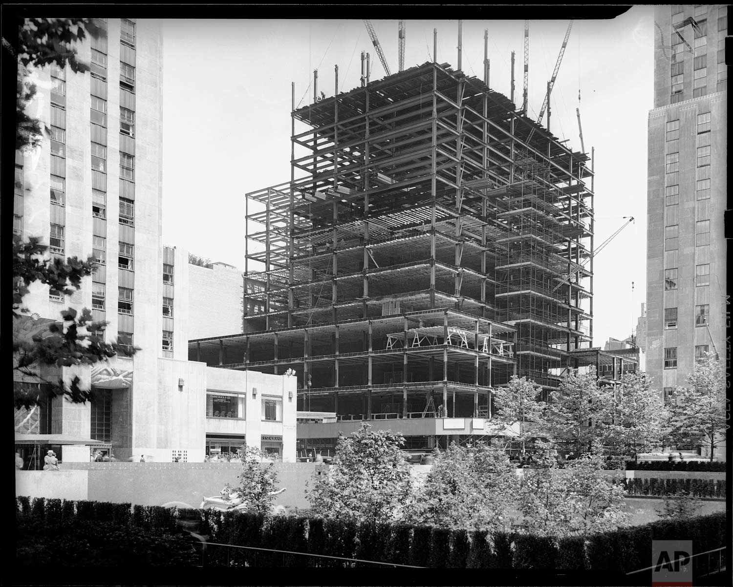 The swiftly growing steel skeleton of the new Associated Press building is shown under construction at Rockefeller Center, New York, June 10, 1938. (AP Photo/Corporate Archives/Joseph W. Brady)