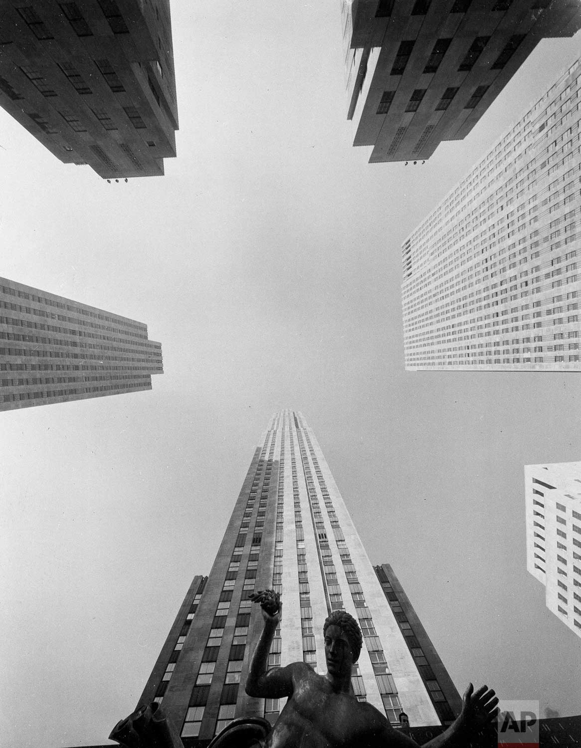 This unusual wide-angel view of New York's Rockefeller Center looks like a photo montage in 1939, but is really a single shot taken from just below the statue of Prometheus. The camera was pointed straight up, taking in 110 degree of sky, building and statue. Just above Prometheus is the RCA building. In clock-wise order come the Time and Life Building, La Maison Francaise, the British Empire Building, the International Building and the Associated Press Building. (AP Photo)