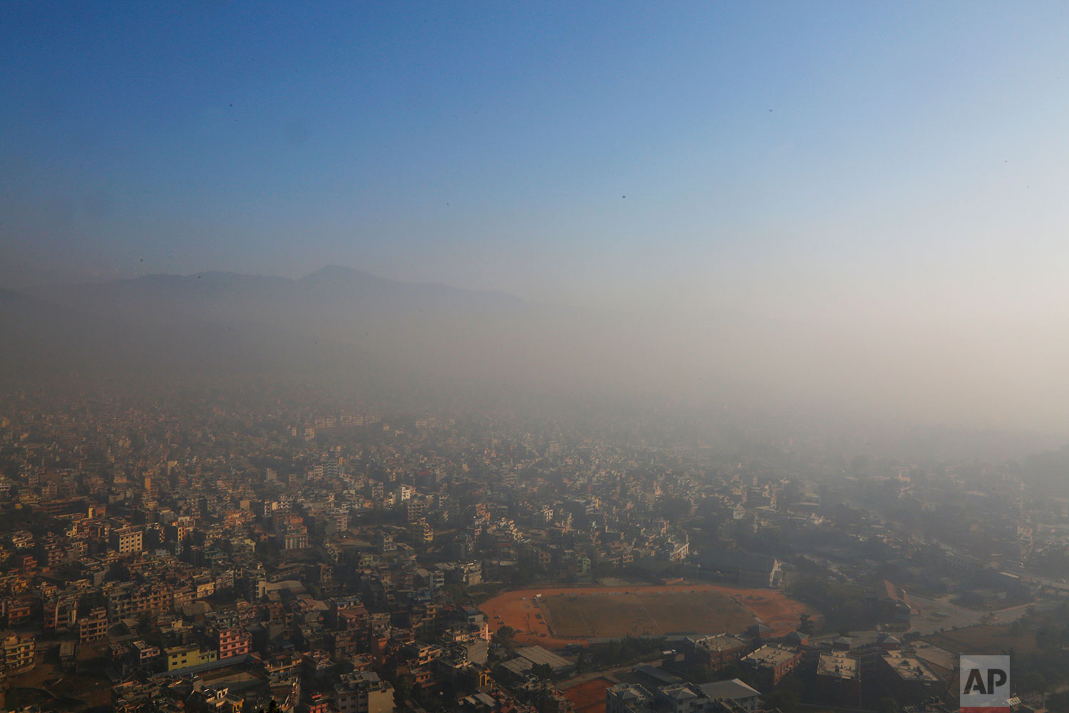 In this Tuesday, Dec. 11, 2018 photo, the smog ridden Kathmandu city is seen atop of hill in Kathmandu, Nepal. (AP Photo/Niranjan Shrestha)