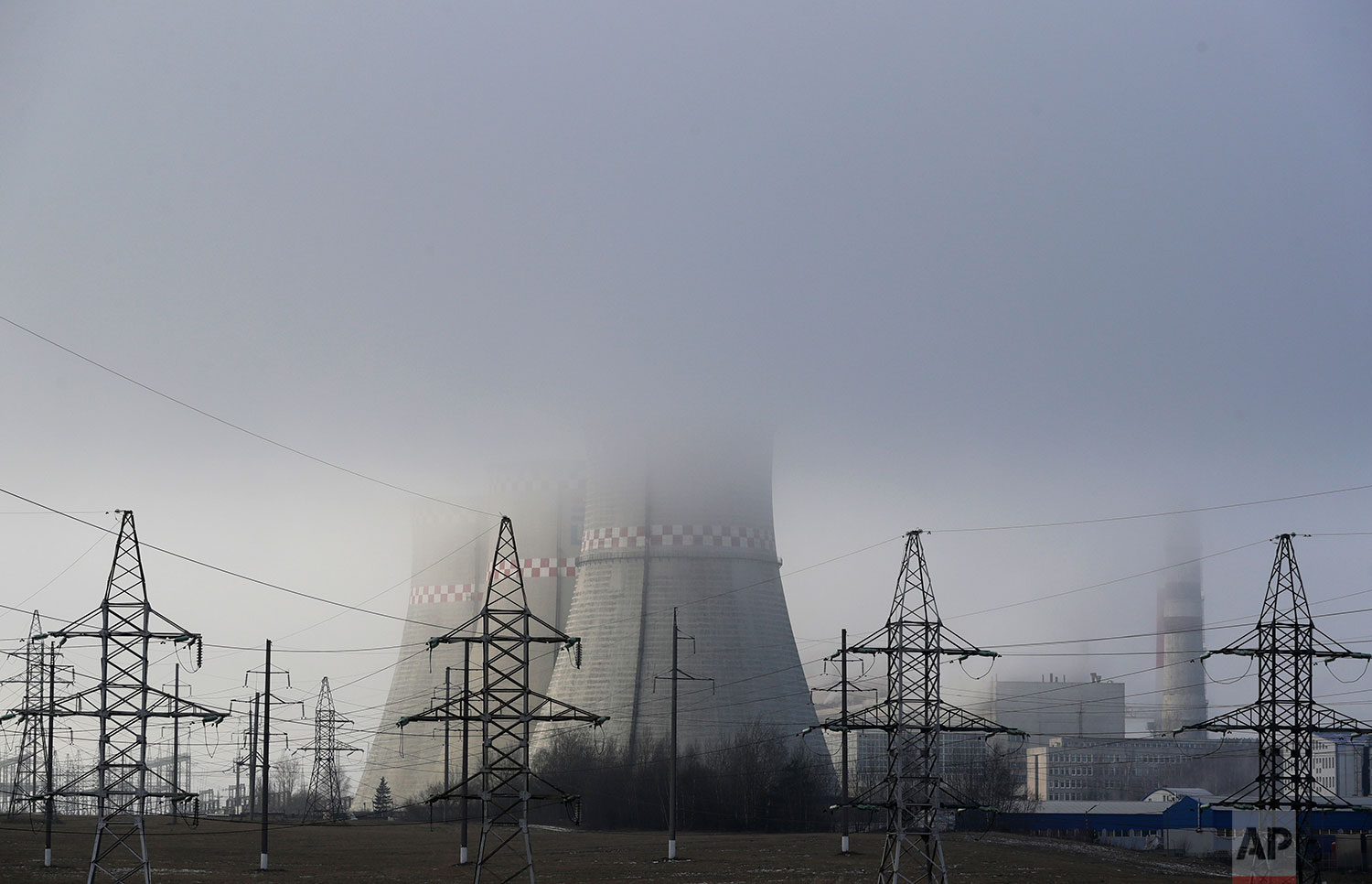 In this Thursday, Dec. 6, 2018 photo, a power plant is partially obscured by fog in Minsk, Belarus. (AP Photo/Sergei Grits)