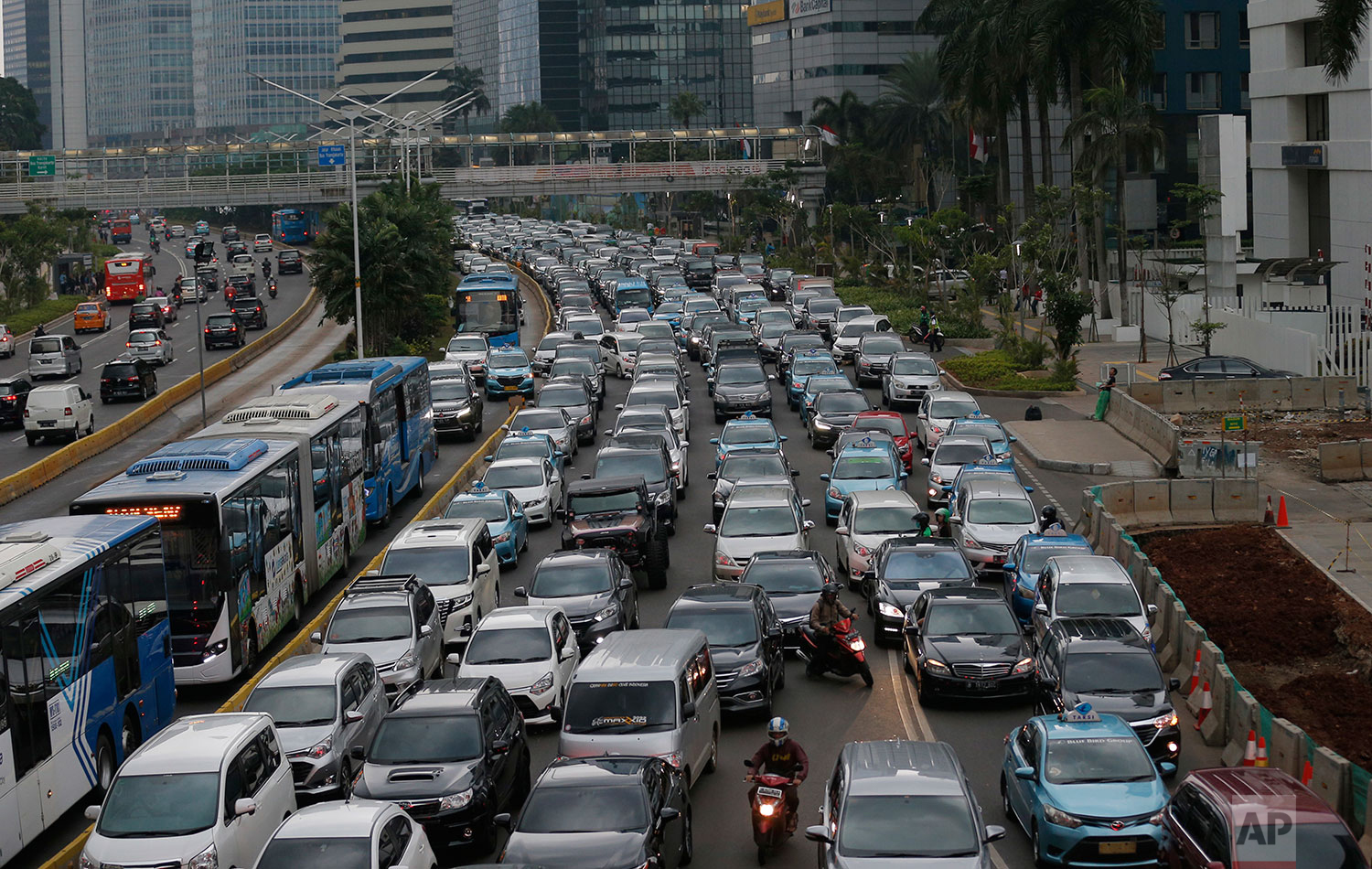 In this Tuesday, Dec. 11. 2018 photo, motorists are stuck in traffic jam during a rush hour at the main business district in Jakarta, Indonesia. (AP Photo/Tatan Syuflana)