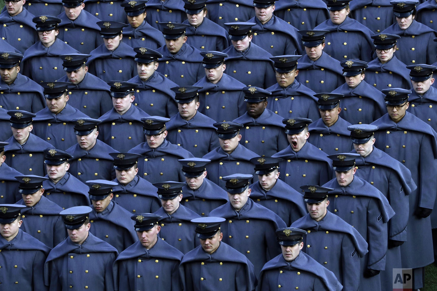 An Army cadet yawns after marching onto the field with others before an NCAA college football game against the Navy team in Philadelphia on Saturday, Dec. 8, 2018. (AP Photo/Matt Slocum)