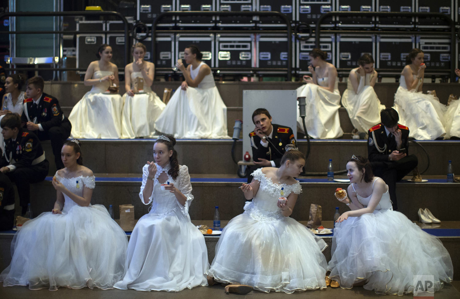 Military school students sit backstage during an annual ball in Moscow, Russia, Tuesday, Dec. 11, 2018. In a revival of a czarist tradition, more than 1,000 students both from military and general schools travelled to the capital from across the country to participate. (AP Photo/Alexander Zemlianichenko)