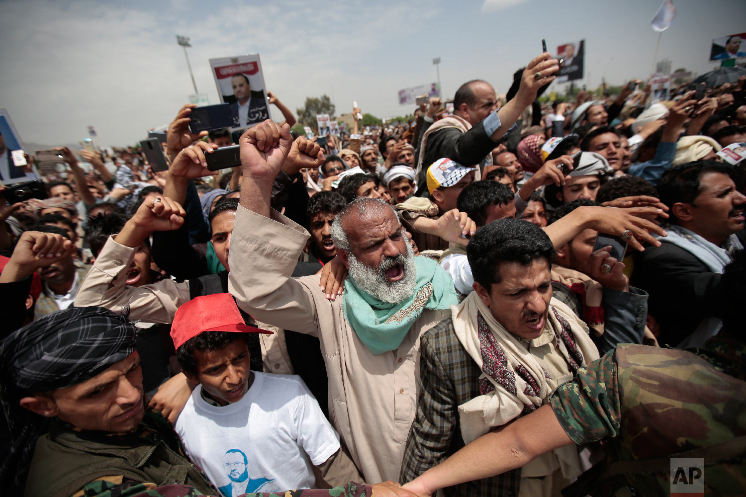 Houthi Shiite mourners chant slogans as they attend the funeral of Saleh al-Samad, a senior Houthi official who was killed by a Saudi-led coalition airstrike on April 19, in Sanaa, Yemen, April 28, 2018. (AP Photo/Hani Mohammed)