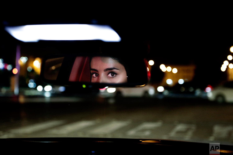 Hessah al-Ajaji drives her car down the capital's busy Tahlia Street after midnight for the first time in Riyadh, Saudi Arabia, June 24, 2018. (AP Photo/Nariman El-Mofty)