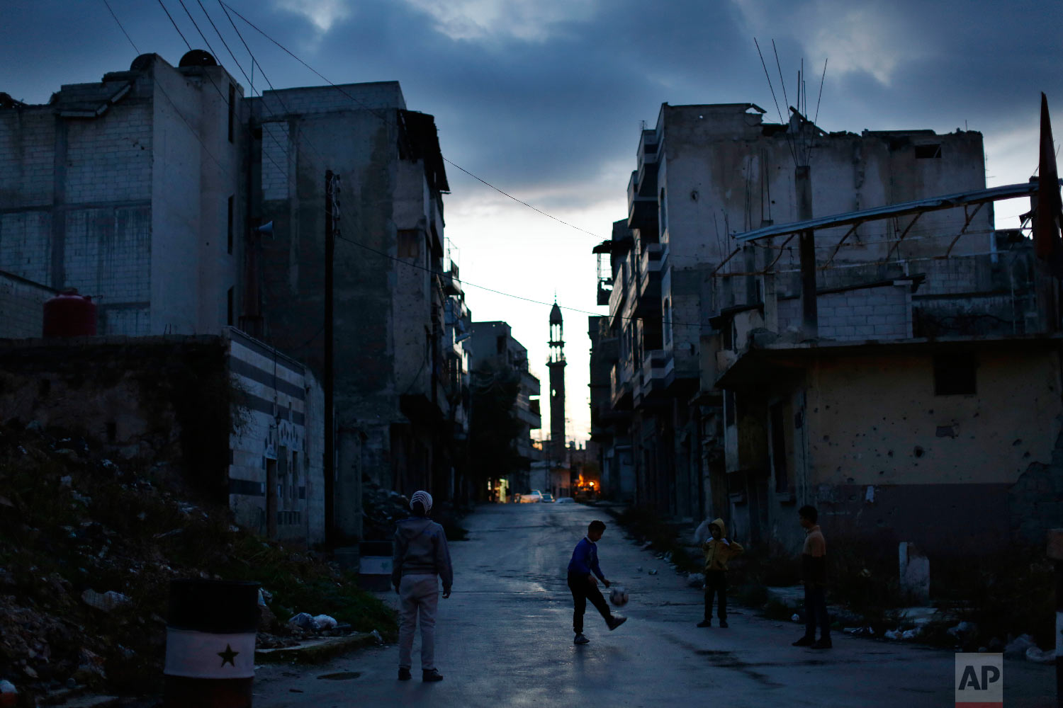 Children play soccer in the war-damaged Bab Dreib neighborhood of the old city, in Homs, Syria, Jan. 16, 2018. (AP Photo/Hassan Ammar)