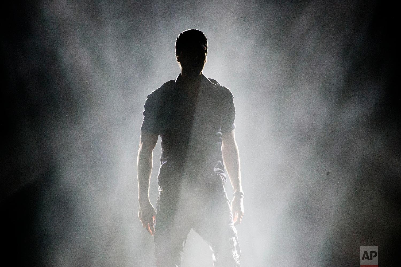 Spanish singer Enrique Iglesias performs on stage in Tel Aviv, Israel, May 27, 2018. (AP Photo/Ariel Schalit)