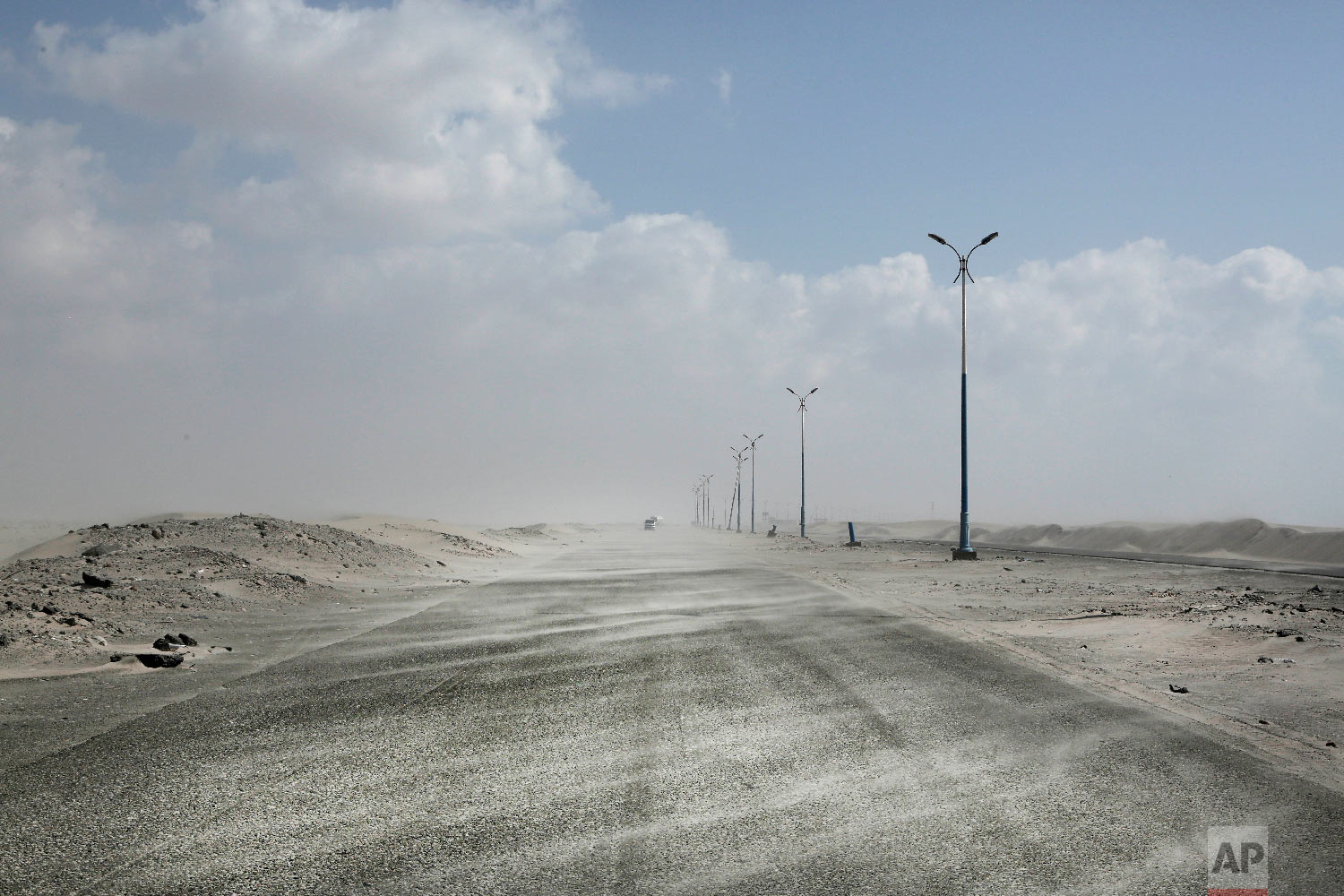 Sand drifts over an empty highway from Abyan to Aden in Yemen on Feb. 15, 2018. (AP Photo/Nariman El-Mofty)