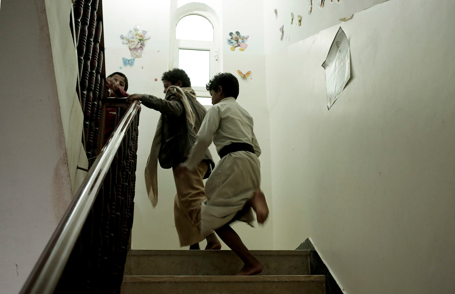 Boys run up the stairs at a rehabilitation center for former child soldiers in Marib, Yemen, in this July 25, 2018, photo. (AP Photo/Nariman El-Mofty)
