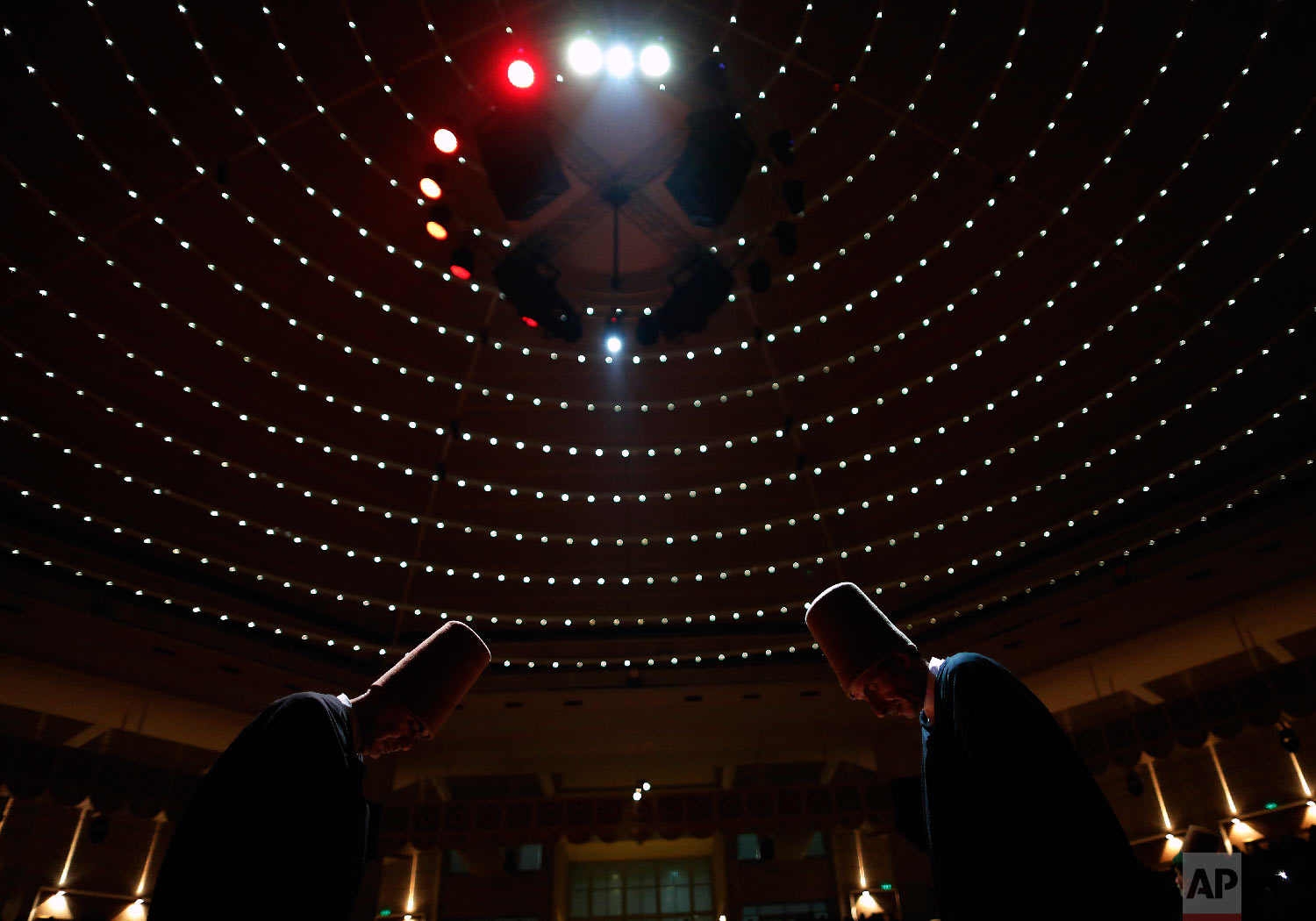 Whirling dervishes of the Mevlevi order bow during a Sheb-i Arus ceremony in Konya, central Turkey, Sunday, Dec. 16, 2018. (AP Photo/Lefteris Pitarakis)