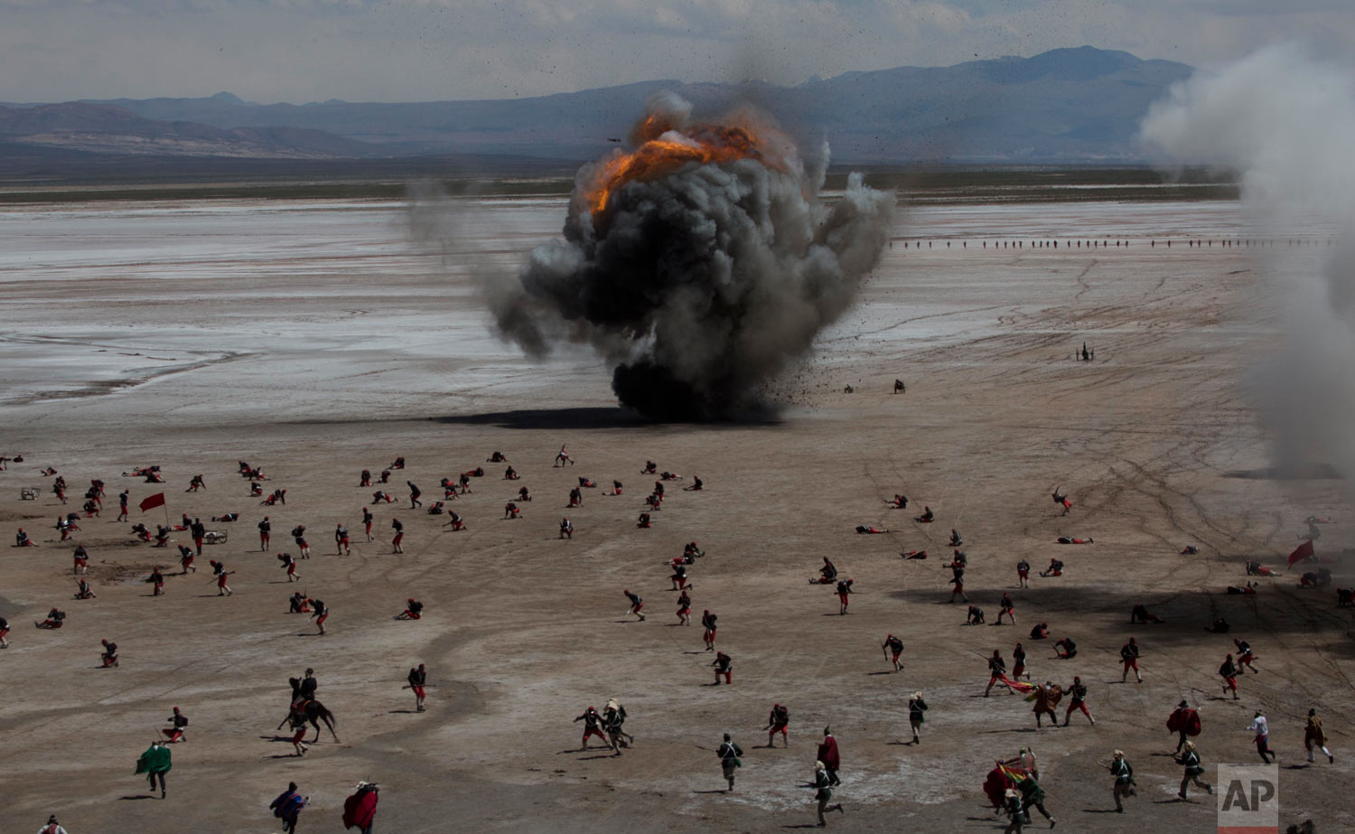 "In this March 28, 2018 photo, Bolivian soldiers re-enact the battle of ""Canchas Blancas,"" which took place during the Pacific War in 1879 when Bolivia lost to Chile, and in effect lost its access to the sea, in Canchas Blancas, Bolivia, the sight of the actual battle. Bolivia lost its legal battle this year at The Hague's International Court of Justice to recuperate the Pacific coastal lands from Chile. (AP Photo/Juan Karita)"