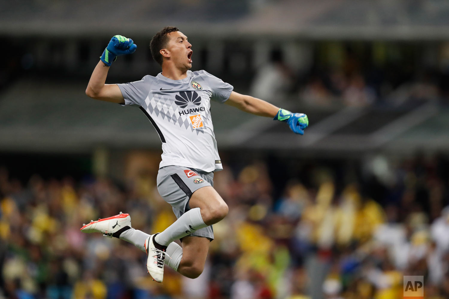 In this March 31, 2018 photo, America's goalkeeper Agustin Marchesin celebrates his team's second goal by teammate Cecilio Dominguez during a Mexico soccer league match against Cruz Azul in Mexico City. (AP Photo/Eduardo Verdugo)